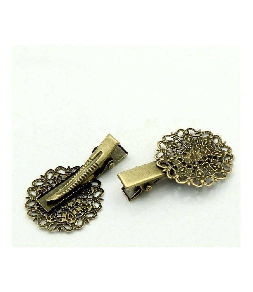 Horquilla de pinza vintage bronce con filigrana redonda