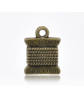 Comprar Charm ovillo de hilo bronce de Conideade