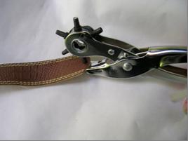 Agujero en cinturon para hacer brazalete