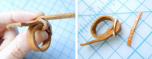 tiras de cuero y anillo en forma de correa